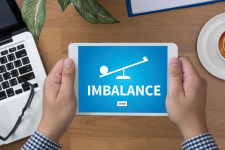 imbalance: IMBALANCE man hand Tablet and coffee cup