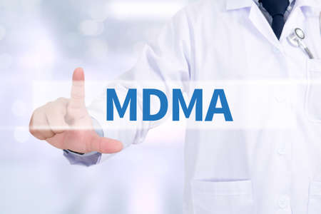 mdma: MDMA Medicine doctor working with computer interface as medical Stock Photo