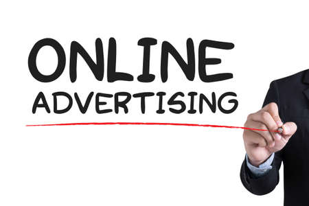 interstitial: ONLINE ADVERTISING Businessman hand writing with black marker on white background