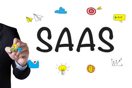 saas fee: SAAS and Businessman drawing Landing Page on white background Stock Photo