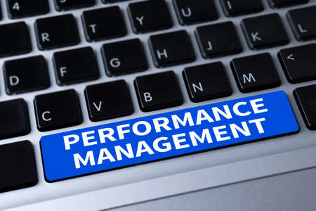 coined: PERFORMANCE MANAGEMENT a message on keyboard