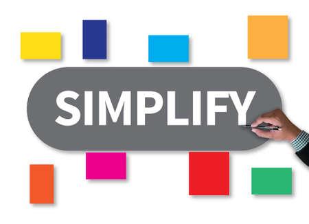 pragmatic: SIMPLIFY businessman work on white broad, top view Stock Photo