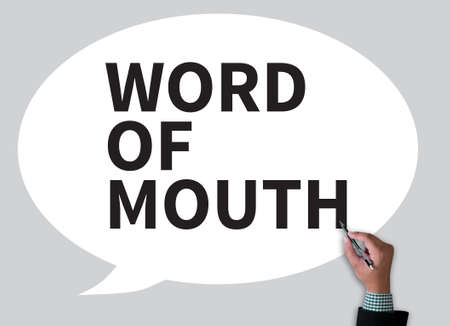 referrer: WORD OF MOUTH businessman work on white broad, top view Stock Photo