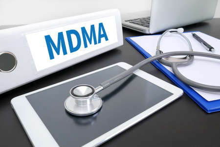 mdma: MDMA folder on Desktop on table. Stock Photo