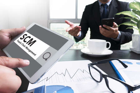 scm: SCM Supply Chain Management concept Businessman pointing at touchpad with data, tablet with isolated screen