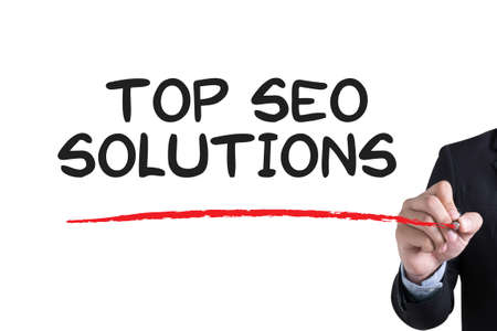 metasearch: TOP SEO SOLUTIONS Businessman hand writing with black marker on white background