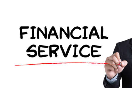 financial service: FINANCIAL SERVICE Businessman hand writing with black marker on white background