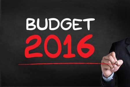 BUDGET 2016 Businessman drawing Landing Page on blackground Stock Photo