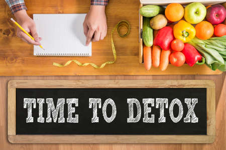 TIME TO DETOX fresh vegetables and  on a wooden table