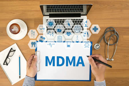 mdma: MDMA Top view, Doctor writing medical records on a clipboard, medical equipment Stock Photo