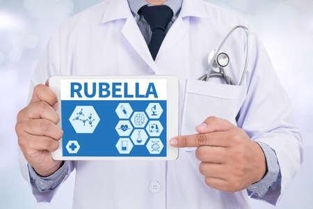 rubella: RUBELLA Doctor holding  digital tablet