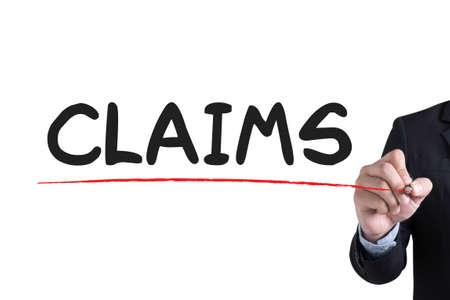 reimbursement: CLAIMS  Businessman hand writing with black marker on white background