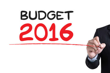 BUDGET 2016 Businessman hand writing with black marker on white background