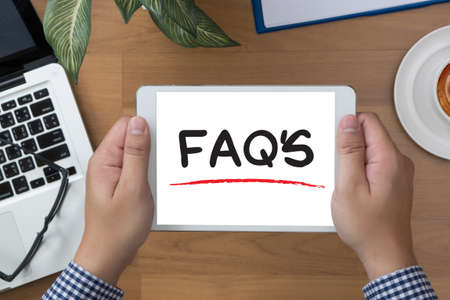 faq's: FAQs Frequently Asked Questions  man hand Tablet and coffee cup