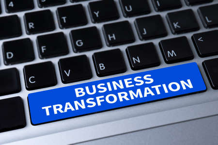 updating: BUSINESS TRANSFORMATION a message on keyboard