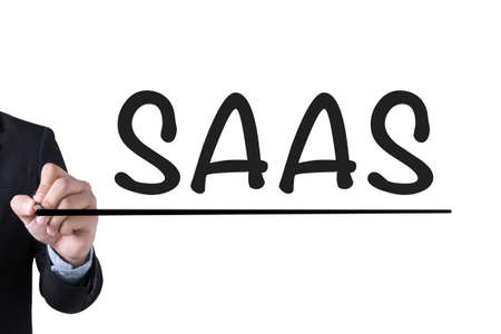 saas fee: SAAS Businessman hand writing with black marker on white background