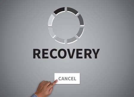 data recovery: RECOVERY (Recovery Backup Restoration Data) businessman work on white broad, top view Stock Photo