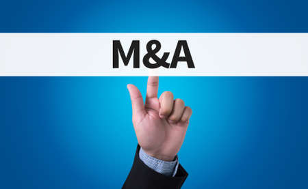 mergers: M&A (MERGERS AND ACQUISITIONS) man pushing (touching) virtual web browser address bar or search bar Stock Photo