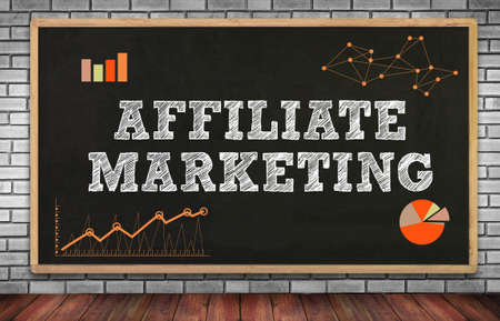contextual: AFFILIATE MARKETING on brick wall and chalkboard background Stock Photo