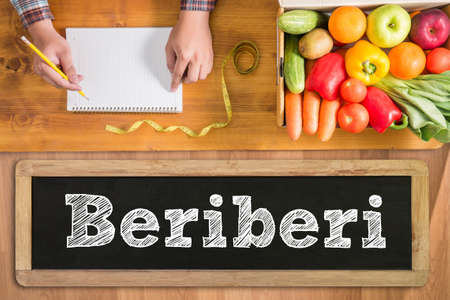 thiamine: Beriberi fresh vegetables and  on a wooden table Stock Photo