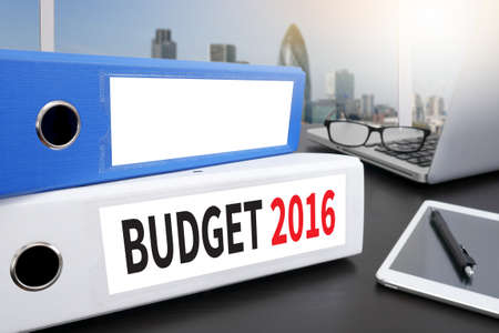 marginal returns: BUDGET 2016 Office folder on Desktop on table with Office Supplies. Stock Photo