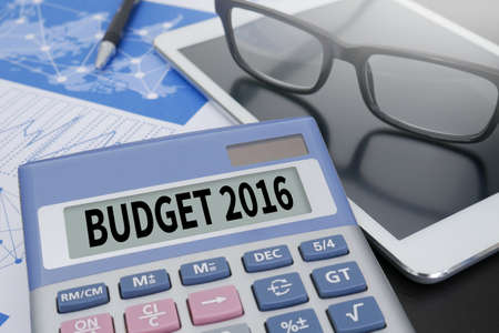 BUDGET 2016 Calculator  on table with Office Supplies. ipad