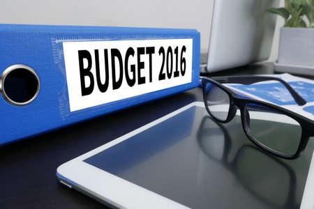 BUDGET 2016 Office folder on Desktop on table with Office Supplies. ipad Stock Photo