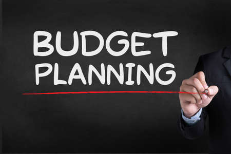 marginal: BUDGET PLANNING Businessman drawing Landing Page on blackground Stock Photo