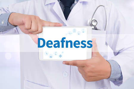 deafness: Deafness Doctor holding  digital tablet Stock Photo