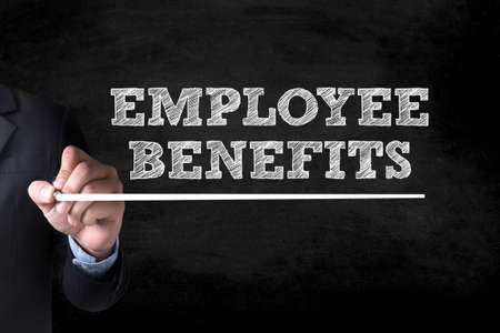 additional compensation: EMPLOYEE BENEFITS and Businessman drawing  Page on blackboard