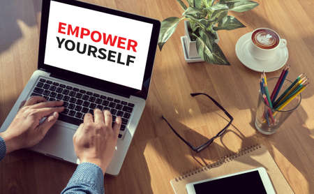 empower: EMPOWER YOURSELF man hand on table Business, coffee, Split tone Stock Photo