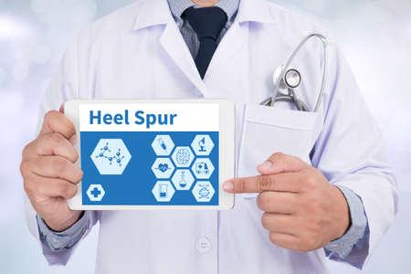 plantar: Heel Spur Doctor holding  digital tablet
