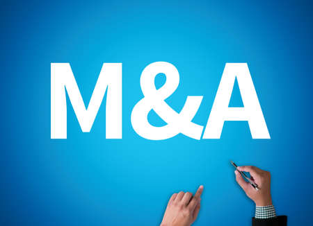 mergers: M&A (MERGERS AND ACQUISITIONS) businessman work on white broad, top view