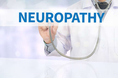 flexion: NEUROPATHY Medicine doctor hand working on virtual screen Stock Photo
