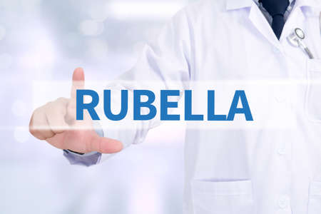 rubella: RUBELLA Medicine doctor working with computer interface as medical Stock Photo