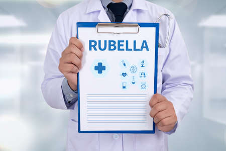 rubella: RUBELLA Portrait of a doctor writing a prescription