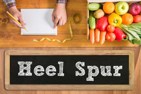 plantar: Heel Spur fresh vegetables and  on a wooden table Stock Photo