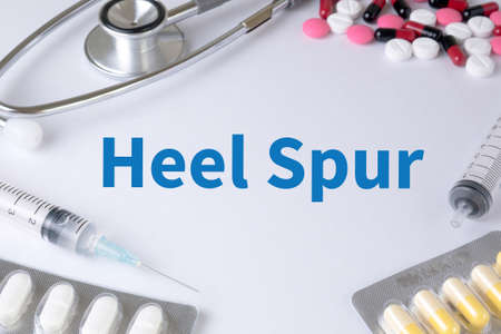 spur: Heel Spur Text, On Background of Medicaments Composition, Stethoscope, mix therapy drugs doctor flu antibiotic pharmacy medicine medical