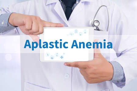 anemia: Aplastic Anemia Doctor holding  digital tablet Stock Photo
