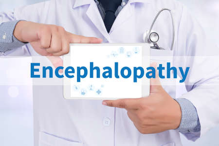 lesions: Encephalopathy Doctor holding  digital tablet