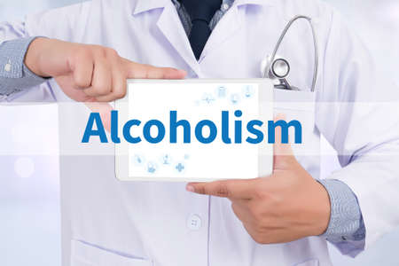 dipsomania: Alcoholism Doctor holding  digital tablet