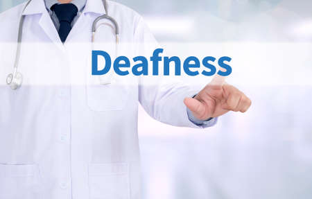 deafness: Deafness Medicine doctor working with computer interface as medical Stock Photo