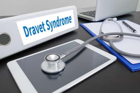 convulsions: Dravet Syndrome folder on Desktop on table.