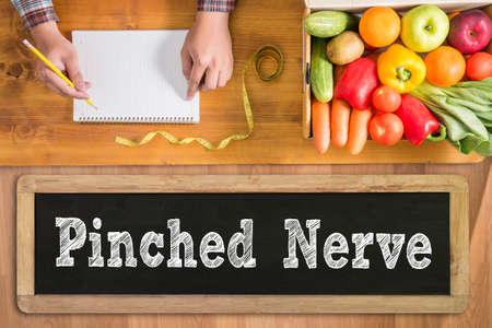 Pinched Nerve fresh vegetables and  on a wooden table