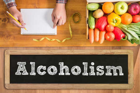 alcoholism: Alcoholism fresh vegetables and  on a wooden table Stock Photo