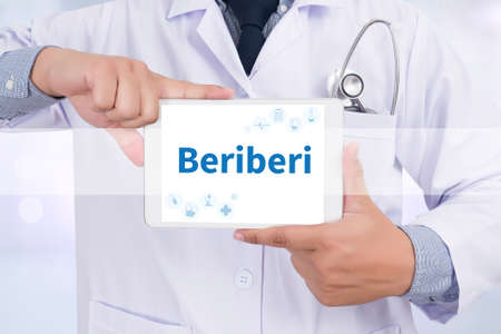 encephalopathy: Beriberi Doctor holding  digital tablet Stock Photo