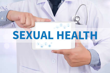 sexual health: SEXUAL HEALTH Doctor holding  digital tablet Stock Photo