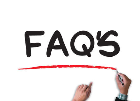 faqs: FAQs Frequently Asked Questions  businessman work on white broad, top view Stock Photo