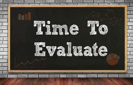reevaluation: Time To Evaluate on brick wall and chalkboard background