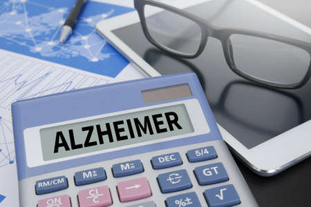 alzheimer: ALZHEIMER Calculator  on table with Office Supplies. ipad